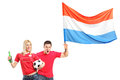 Male and female euphoric fan with dutch flag Royalty Free Stock Image