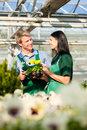 Male and female florist or gardener in flower shop or nursery market garden Stock Images