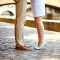 Male and female legs during a date closeup of Royalty Free Stock Photo