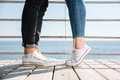 Male and female legs on a date at the seaside Royalty Free Stock Photography