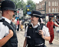 Male female police officers street east london Royalty Free Stock Image