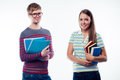 Male and female students holding book Stock Photo
