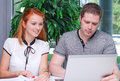Male and female students studying using laptop Royalty Free Stock Images