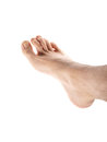 Male foot right isolated towards white background with hair on leg Stock Photography