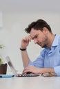 Male freelancer  thinking Royalty Free Stock Photo