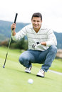 Male golf player at the course holding a club Stock Image