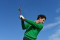 Male golf swing on a beautiful day Stock Photography