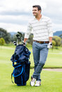Male golfer at the course with a golf sack Stock Images