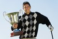 Male Golfer Holding Trophy Royalty Free Stock Photo