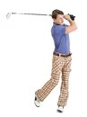 Male golfer swinging his club Royalty Free Stock Photo