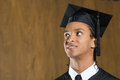 Male graduate looking up Royalty Free Stock Photo