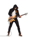 Male guitarist plays the bass giutar. Royalty Free Stock Photo
