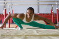 Male gymnast stretching in gymnasium smiling portrait Royalty Free Stock Photos