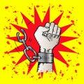 Male hand breaking steel handcuffs.