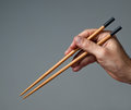 Male hand with chopsticks chinese Stock Photography