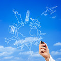 Male hand drawing the top travel destinations from all over world with sky as background Royalty Free Stock Image