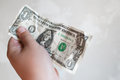 Male hand hold one dollar bill in giving gesture Royalty Free Stock Photo