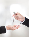 Male hand holding apartment keys and handing it over to another person Royalty Free Stock Photos