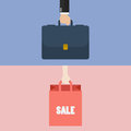 Male hand holding briefcase and female hold shopping bag Royalty Free Stock Photo