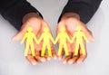 Male Hand Holding Family Cutout Shape Royalty Free Stock Photo