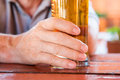Male hand holding glass of freshly tapped beer close up Royalty Free Stock Photography