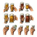 Male hand holding a glasses with beer, tequila, vodka, rum, whiskey and ice cubes.