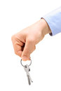 A male hand holding keys on a key ring Stock Image