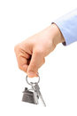 Male hand holding keys on a key ring Stock Photo