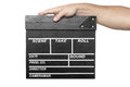 Male hand holding movie production clapper board isolated on white background Royalty Free Stock Photo