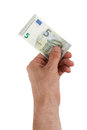 Male hand holding a new euro bills isolated on white Stock Photography