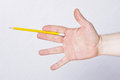 Male hand holding pencil