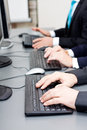 Male hand on keyboard typing and scroll mouse Royalty Free Stock Photo