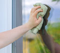 Male hand with rag washing window outdoors Royalty Free Stock Photography