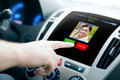 Male hand receiving video call on car panel screen Royalty Free Stock Photo