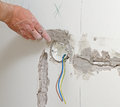 Male hand repairs wall with spackling paste Stock Images