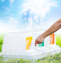 Male hand throwing empty plastic bottle into the trash, ecology Royalty Free Stock Images