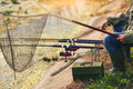 Male hands holding fishing rod Royalty Free Stock Photo