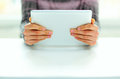 Male hands holding tablet computer closeup image of Stock Images