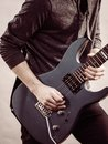Male hands playing electric guitar Royalty Free Stock Photo
