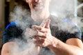 Male hands smeared talcum powder