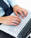 Male hands typing on a laptop Stock Photo