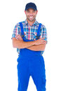 Male handyman standing arms crossed over white background Royalty Free Stock Photo