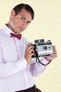 Male holding medium format camera portrait of a retro styled a antique film Royalty Free Stock Photo