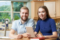 Male Home Tutor Helping Teenage Girl With Studies Royalty Free Stock Photo