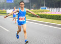 Male marathon runner running on the shenzhen international shennan road shenzhen city china december Stock Images