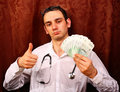 Male medicine doctor in hold euro money and show OK Royalty Free Stock Photo