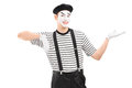 Male mime artist gesturing with hand isolated against white background Stock Photos