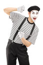 Male mime artist gesturing isolated against white background Stock Photo