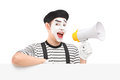 Male mime artist holding a loudspeaker and posing on a blank pan panel isolated white background Stock Photos