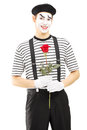 Male mime artist holding a rose flower isolated against white background Stock Images